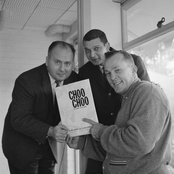 "Bob Quincy, Julian Scheer and Charlie Justice with copy of ""Choo Choo: The Charlie Justice Story"""