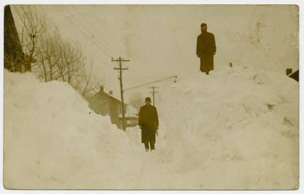 [Two Men on Piles of Snow]