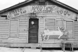 Cafes: Hardtimes Mississippi Cafe. Lorman, Miss. Interior and exterior of cafe, reclining cat sign (CP 5-76-6 #206)